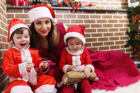 Santa Claus couple with twins