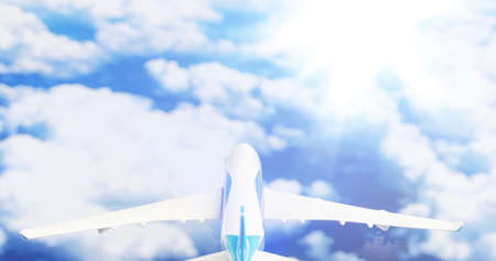 The travel by plane flies in the sky above the clouds. 写真素材