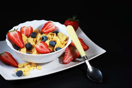 Ready breakfast corn flakes with fresh berries.