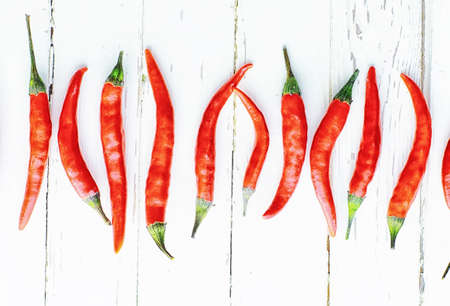 Hot red pepper on white wooden vintage background.