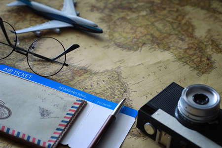 Travel concept. Map on the table and model aircraft.