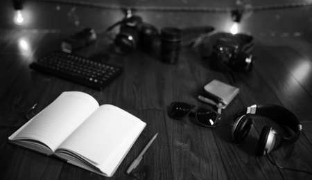 The photographer's desk, digital camera accessories and lenses. Stock Photo