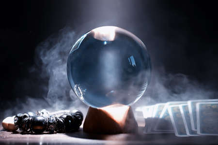 Crystal ball predict the fate. Guessing for the future. Archivio Fotografico - 130380740