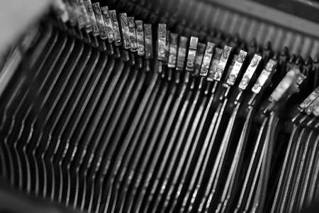 Different small metal elements of an old typewriter macro.