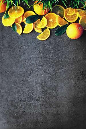 Orange citrus fruit on stone table. Orange background. Stock Photo