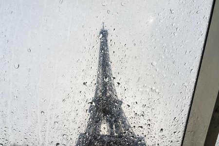 Raindrops on Eiffel Tower background.
