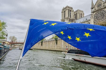 The flag of the European Community over the Seine. Paris, France Фото со стока
