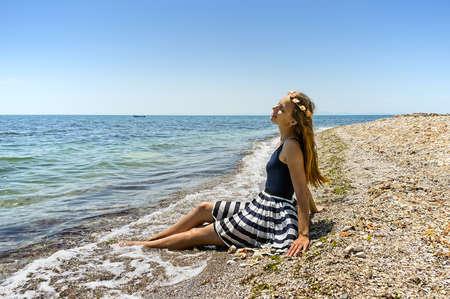 Beautiful young girl enjoying by the sea
