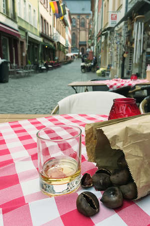 glass of whiskey and roasted chestnuts, old city, Getinberg, Germany