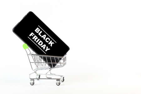 Smatrfon in a shopping trolley with the inscription BLACK FRIDAY, isolate on white.
