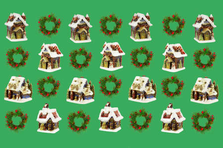 Christmas houses and wreaths of spruce branches on a light green background.