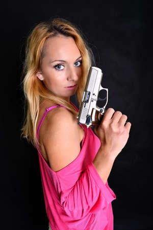 woman with gun photo