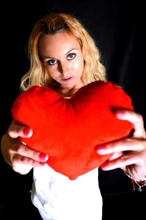 portrait of attractive caucasian smiling woman with heart Stock Photo - 20536969
