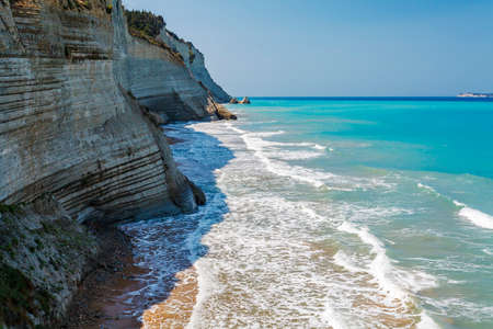 View of sea waves lapping on the rocks. Corfu. Greece. Stock Photo