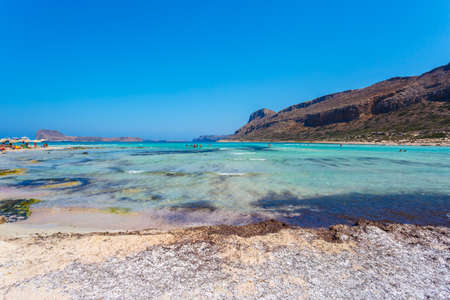 gritty: View of sunbathing people on gritty beach of Balos lagoon on Crete. Greece. Stock Photo