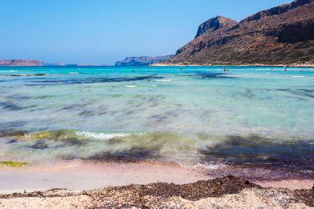 beautiful location: View of sunbathing people on gritty beach of Balos lagoon on Crete. Greece. Stock Photo