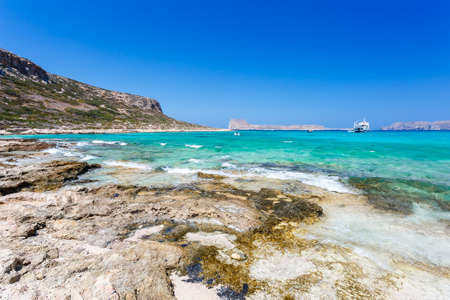 beautiful location: View of sunbathing people on beach of Balos lagoon on Crete. Greece. Stock Photo
