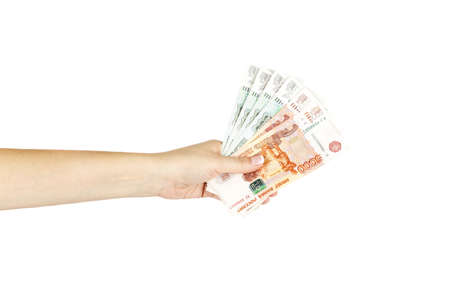 women's hand: Isolated womens hand holds russian money on a white background. Stock Photo