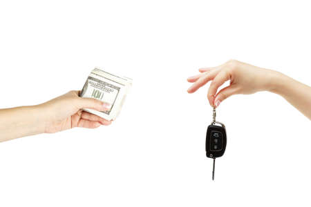 keyless: Isolated holding hands with car keys and stack of dollars on white background. Stock Photo