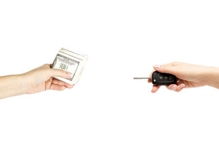 keyless: Isolated holding female hands with keys of car and stack of dollars on white background.
