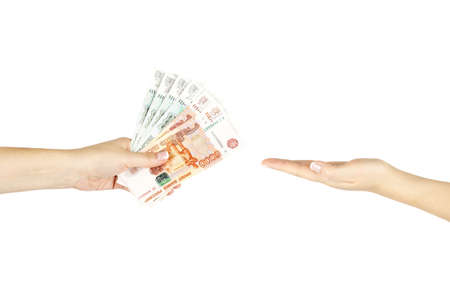 Bribery concept with womens hands on white isolated background.