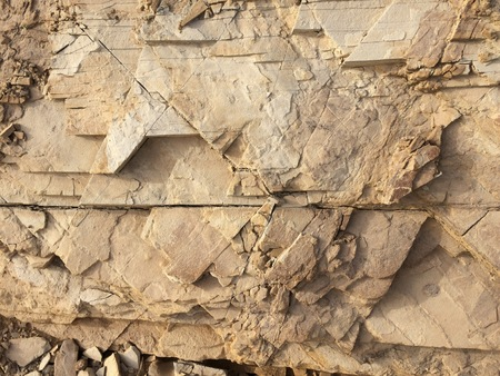 Rock as a background, stone texture, faults in rock, hard material Stock Photo