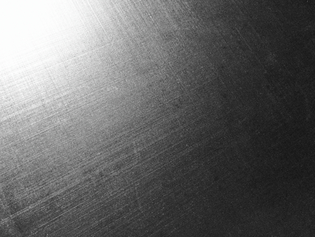 corrugated metal alloy as a background, metal surface, aluminum alloy, magnesium alloy, sun flare, grainy texture