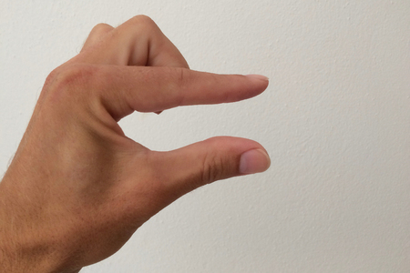 white man's palm, outstretched palm, hand on a white background, part of the body, part of the hand, white skin, two fingers, show the number, hand gesture, small part, small size