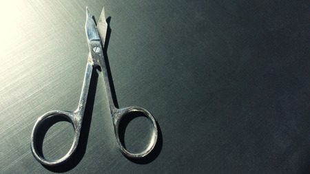 small nail scissors on a dark background, nail scissors, small scissors, dark background Imagens