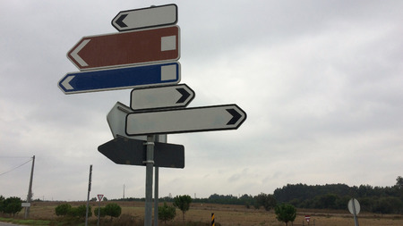 traffic signs showing in different directions, lot of ways, variability of choice, crossroads