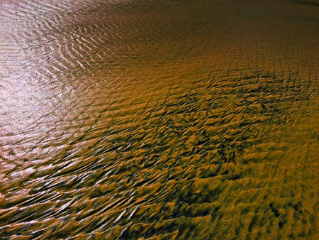 patterns created оn the sand by waves and wind, sand pattern as background Stock Photo