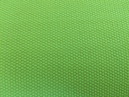 painted rubber as background, rough surface, green background
