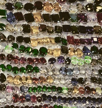 bright cheap women's bijouterie, jewelry, shiny glass, background 免版税图像