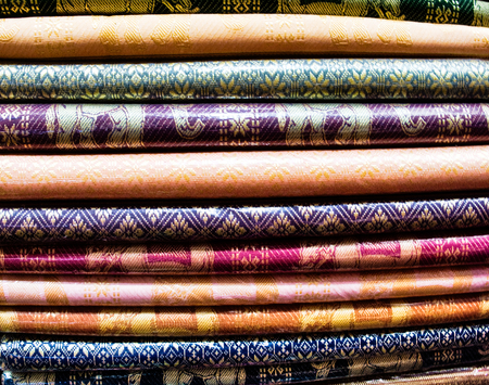 Colorful fabric cuts, folded one on one, woven texture, background 免版税图像