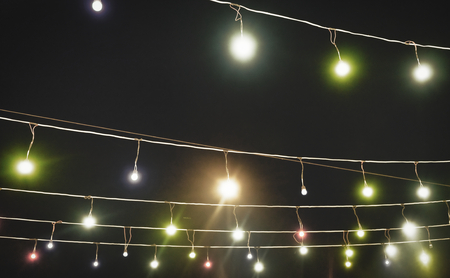garland with colored lights, decorative lighting, background Reklamní fotografie
