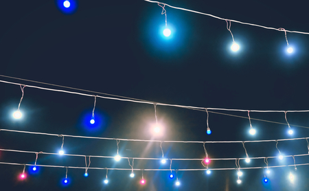 garland with colored lights, decorative lighting, background Stock Photo