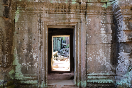 Doorway of an old stone building. A passage in the wall. Imagens