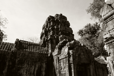 The ruins of an ancient Hindu temple in the Cambodian jungle. Warm sunny day. Masterpieces of the world architectural art.