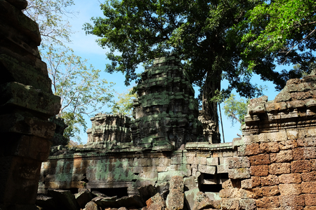 Ancient stone tower of an abandoned temple complex in Southeast Asia. Architectural heritage of the Khmer Empire.