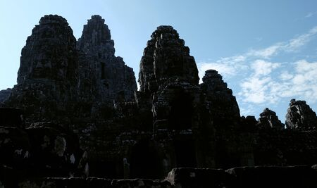 Monumental ancient temple of Bayon in Cambodia. Medieval temple in Indochina. Architectural art of ancient civilizations. Bayon temple in Angkor Thom. Face towers.