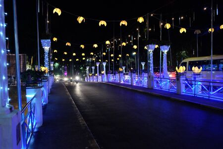 A bridge illuminated by street lamps at night. Beautiful street lighting.