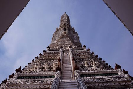 Steps leading to one of the tower of Wat Arun temple. Stock Photo - 135251411