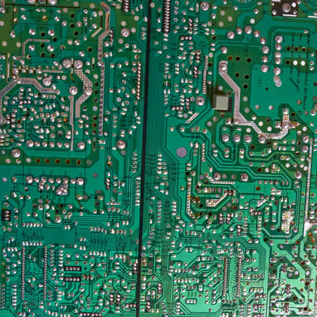 Chernihiv region, Ukraine, April 25, 2019. Green computer circuit board as a background. Chip.