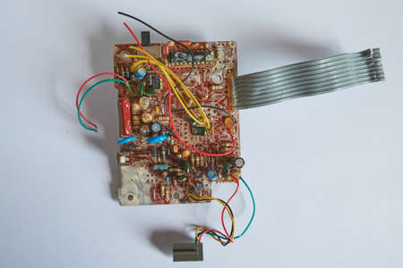 Chernihiv region, Ukraine, April 25, 2019. Old printed circuit board with many wires and elements. Editorial