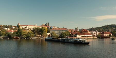 Pleasure boat on the Vltava pier in the fall. View of Prague.