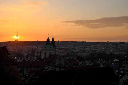 Dawn over Prague. The urban skyline of an ancient European city at dusk.