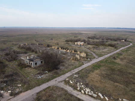 Destroyed livestock farm in the north of Ukraine, aerial view. Dilapidated industrial buildings.