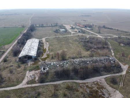 Abandoned farm, aerial view. Dilapidated industrial buildings. 写真素材