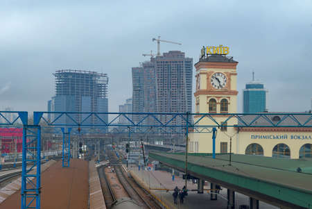 Kyiv, Ukraine, February 25, 2020. Platforms of the Kiev suburban railway station against the background of houses under construction. Railway station.