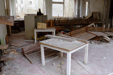 Old broken furniture in an abandoned building in Pripyat. A room in an abandoned kindergarten in the Chernobyl exclusion zone.